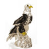 Eagle with closed wings on a transparent base
